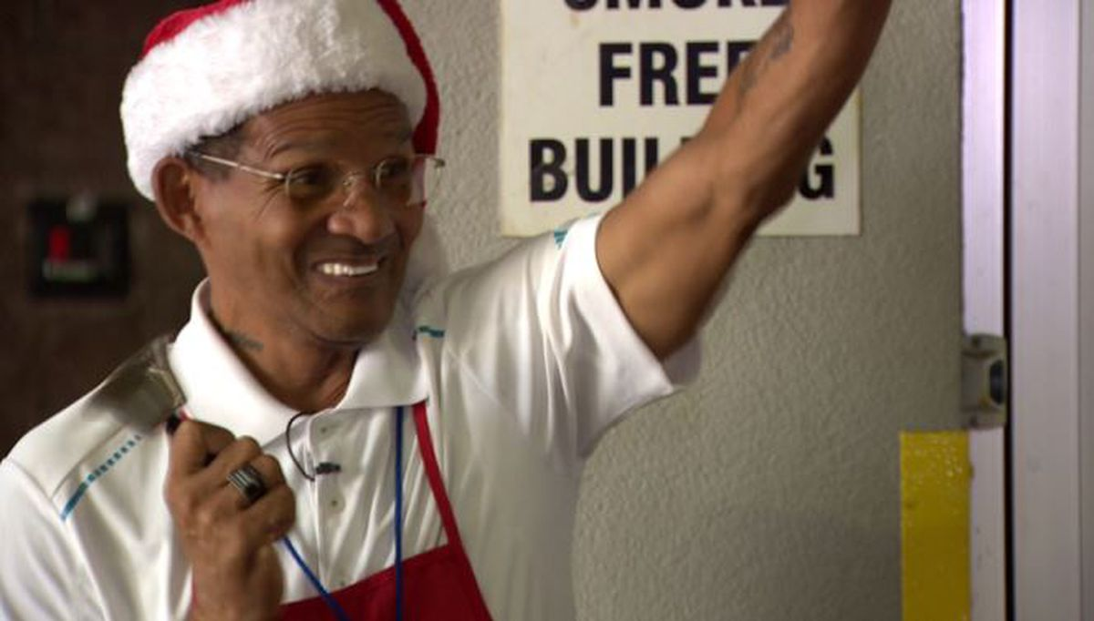 Kettle bell ringer spreads warm tidings of joy by giving back to the organization that saved his life