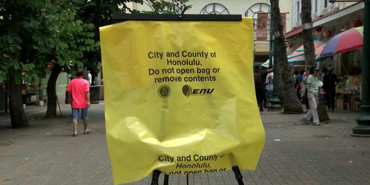 Bright yellow garbage bags are the city's solution to Chinatown's trash problem