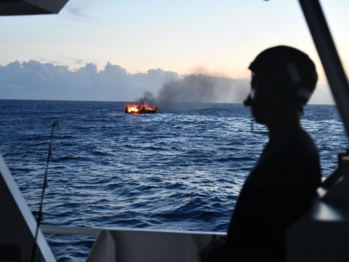 Fishing vessel that caught fire sinks in waters off Oahu's south shore