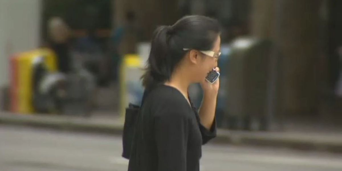 'Good law' or 'dumb law'? Opinions on new distracted walking measure vary