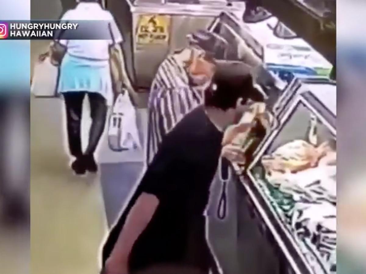 Surveillance video captures man swiping 95-year-old man's wallet at market