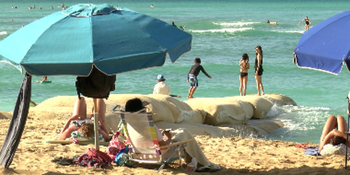 Engineers hope high-tech sandbags will keep the beach in Waikiki from disappearing