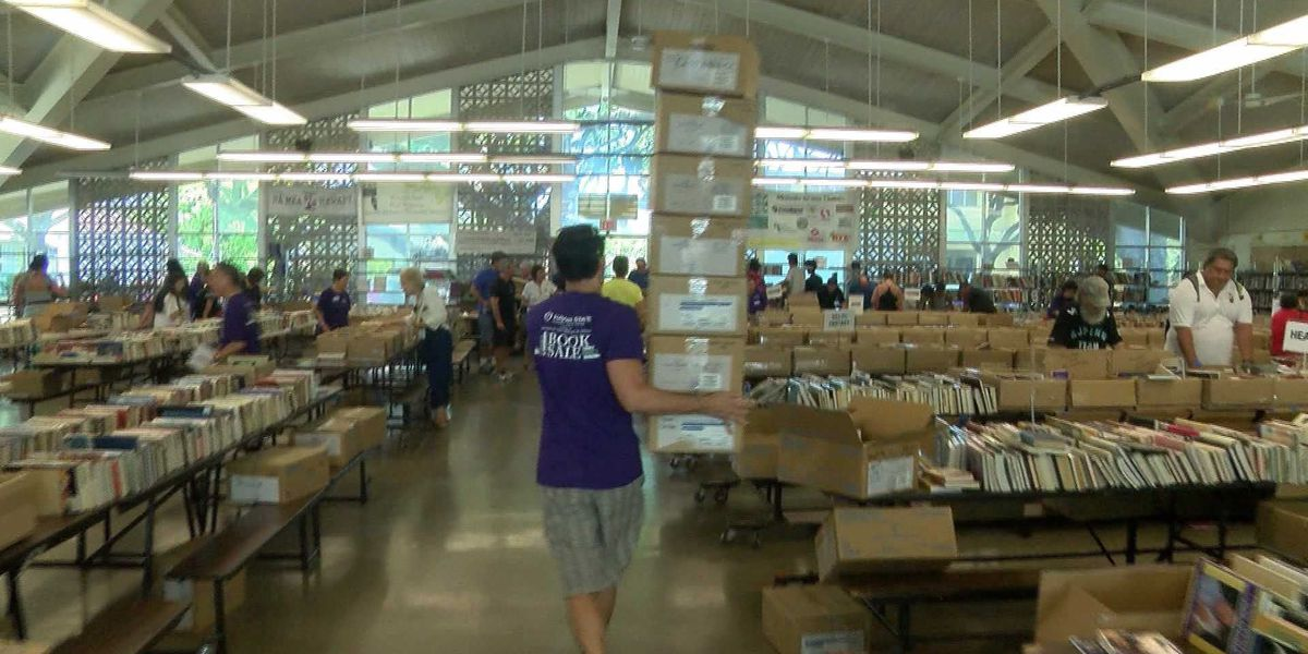 Volunteers pack 10,000 books to donate to Micronesia to increase literacy