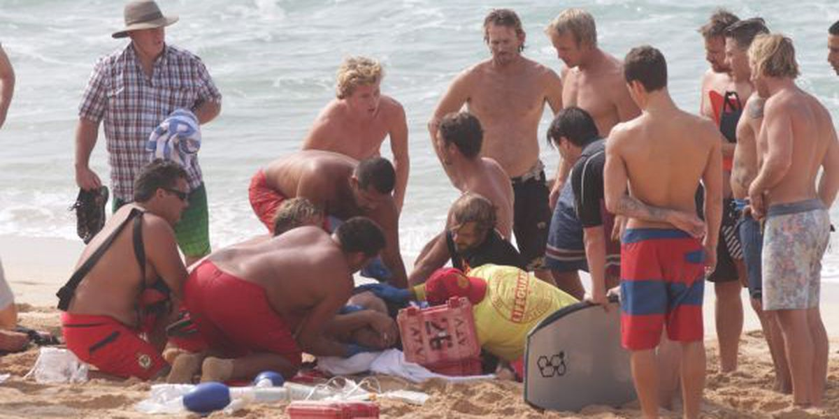 Lifeguards rescue bodyboarder from big North Shore surf