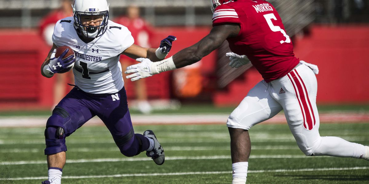 He's Number 1! Northwestern football presents Iolani grad with coveted jersey