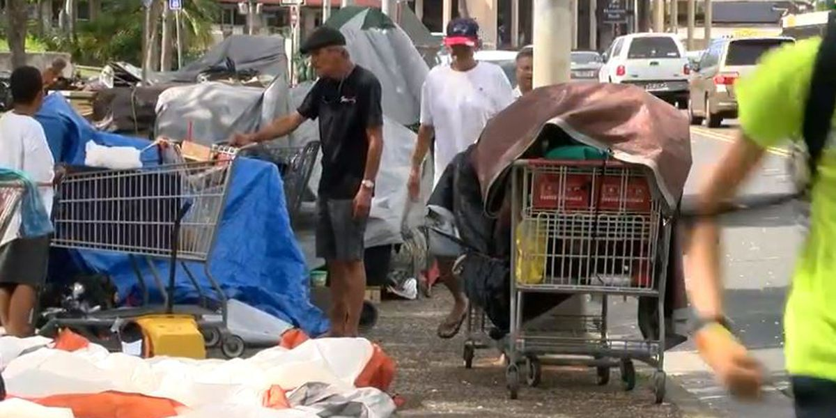 Mayor signs 2 laws aimed at pushing homeless from sidewalks
