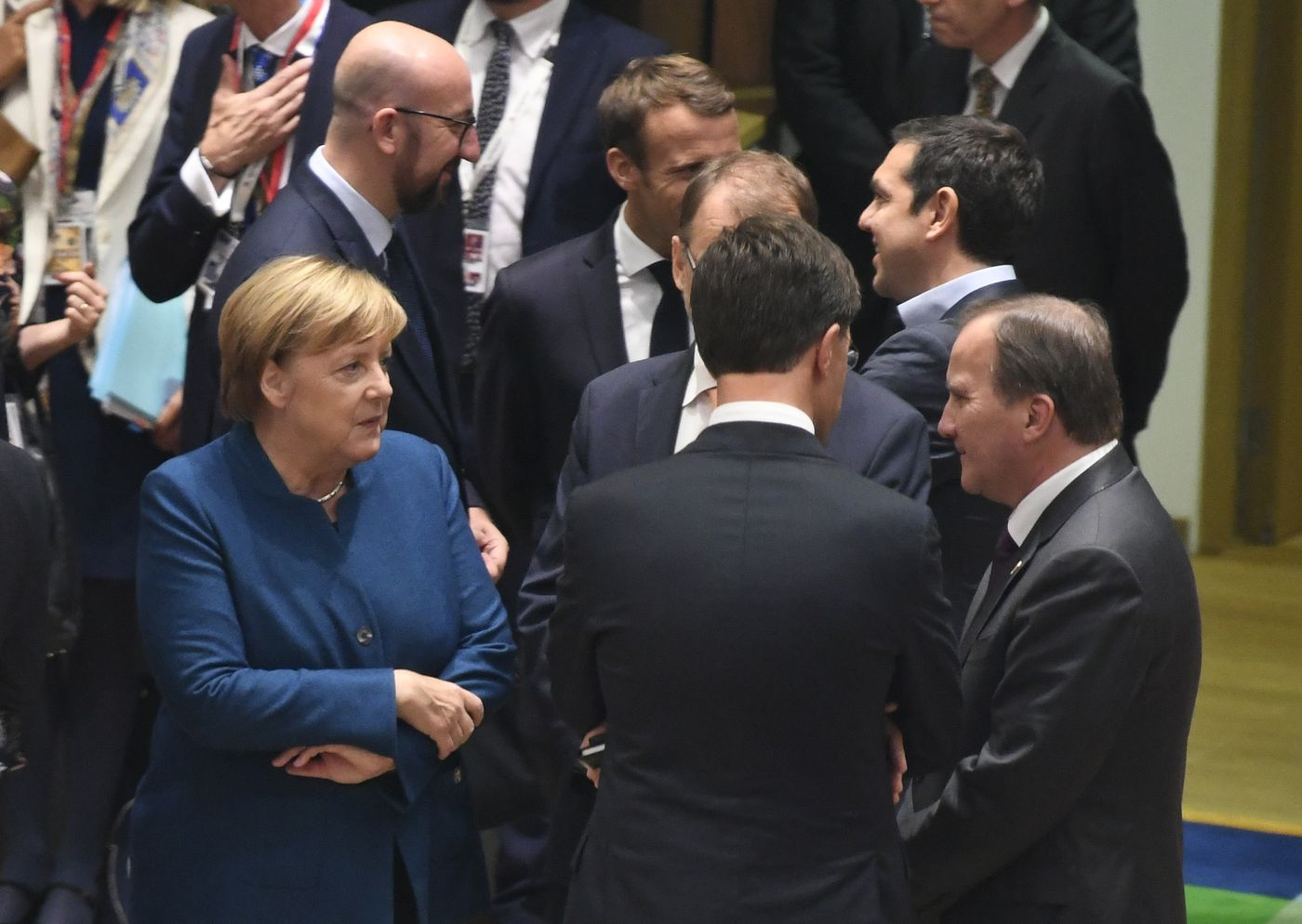 """German Chancellor Angela Merkel, left, speaks with Swedish Prime Minister Stefan Lofven, right, and Dutch Prime Minister Mark Rutte, center, during a round table at an EU summit in Brussels, Wednesday, Oct. 17, 2018. European Union leaders are converging on Brussels for what had been billed as a """"moment of truth"""" Brexit summit but which now holds little promise for a breakthrough. (Piroschka van de Wouw, Pool Photo via AP)"""