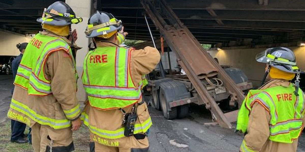 Large roll-off truck hits the H-1 overpass above University Ave., seriously injuring 1