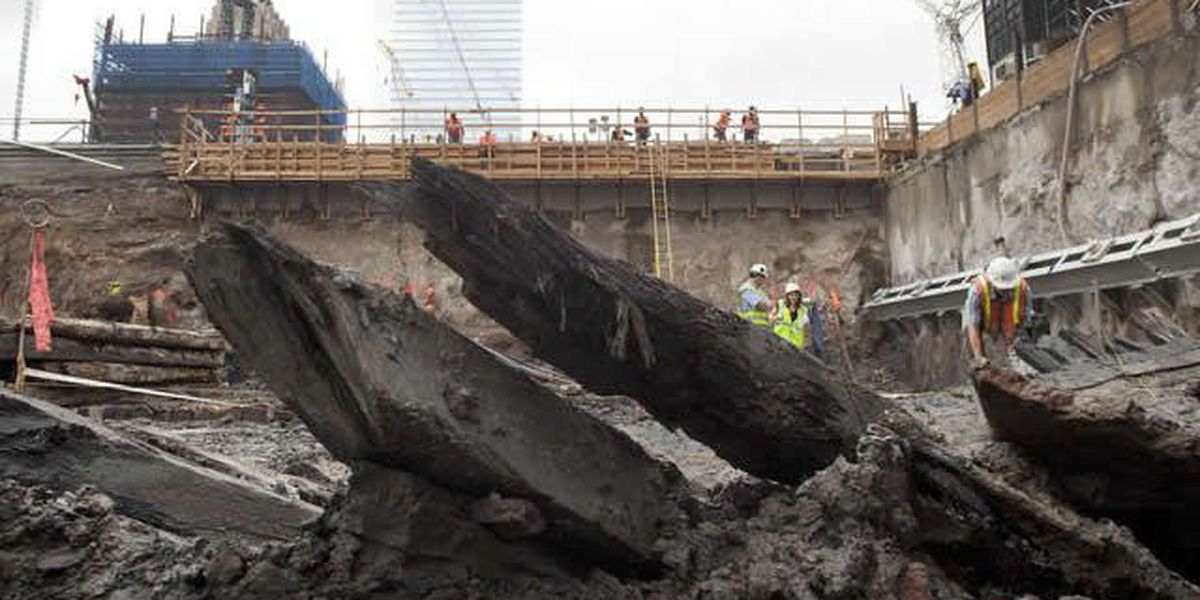 Experts work to free buried ship hull at WTC site