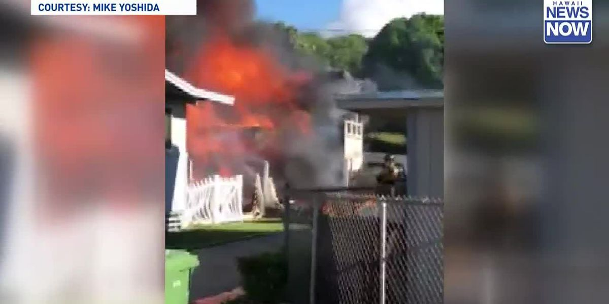 Firefighters respond to a two-alarm house fire in Kahala