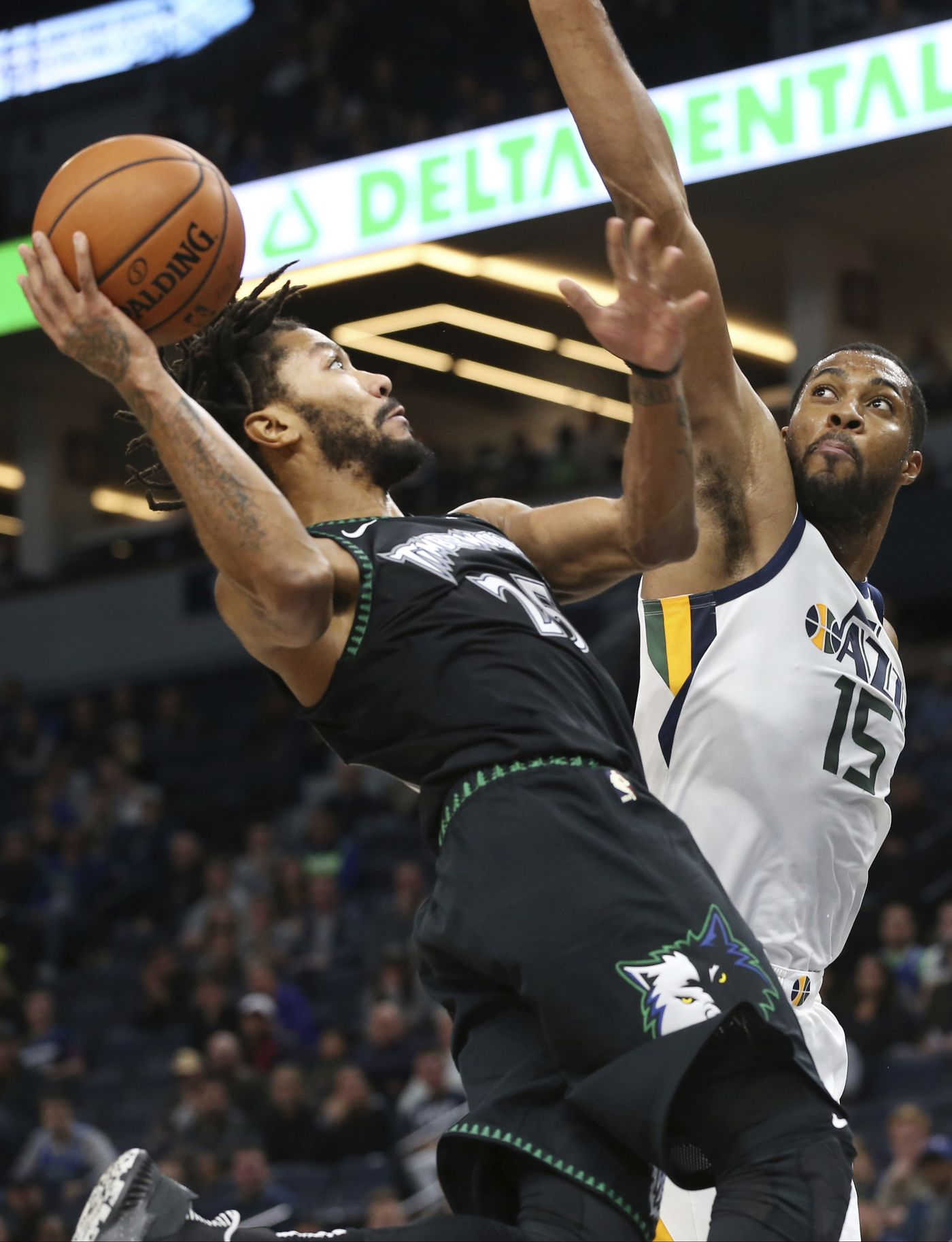 1dc2a3b0 Minnesota Timberwolves' Derrick Rose, left, shoots as Utah Jazz's Derrick  Favors defends during