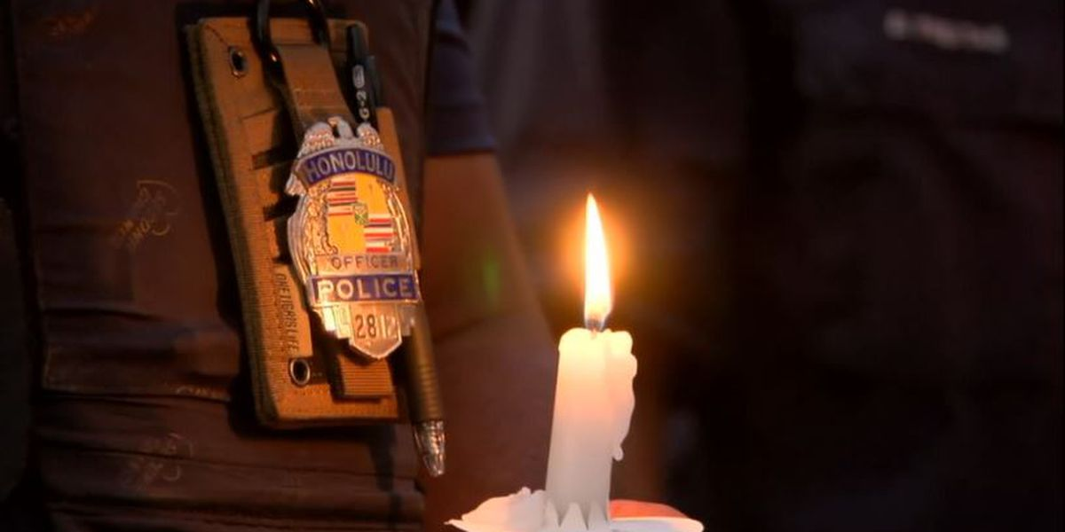 Candles and memories shine bright at a vigil honoring HPD's 2 fallen officers