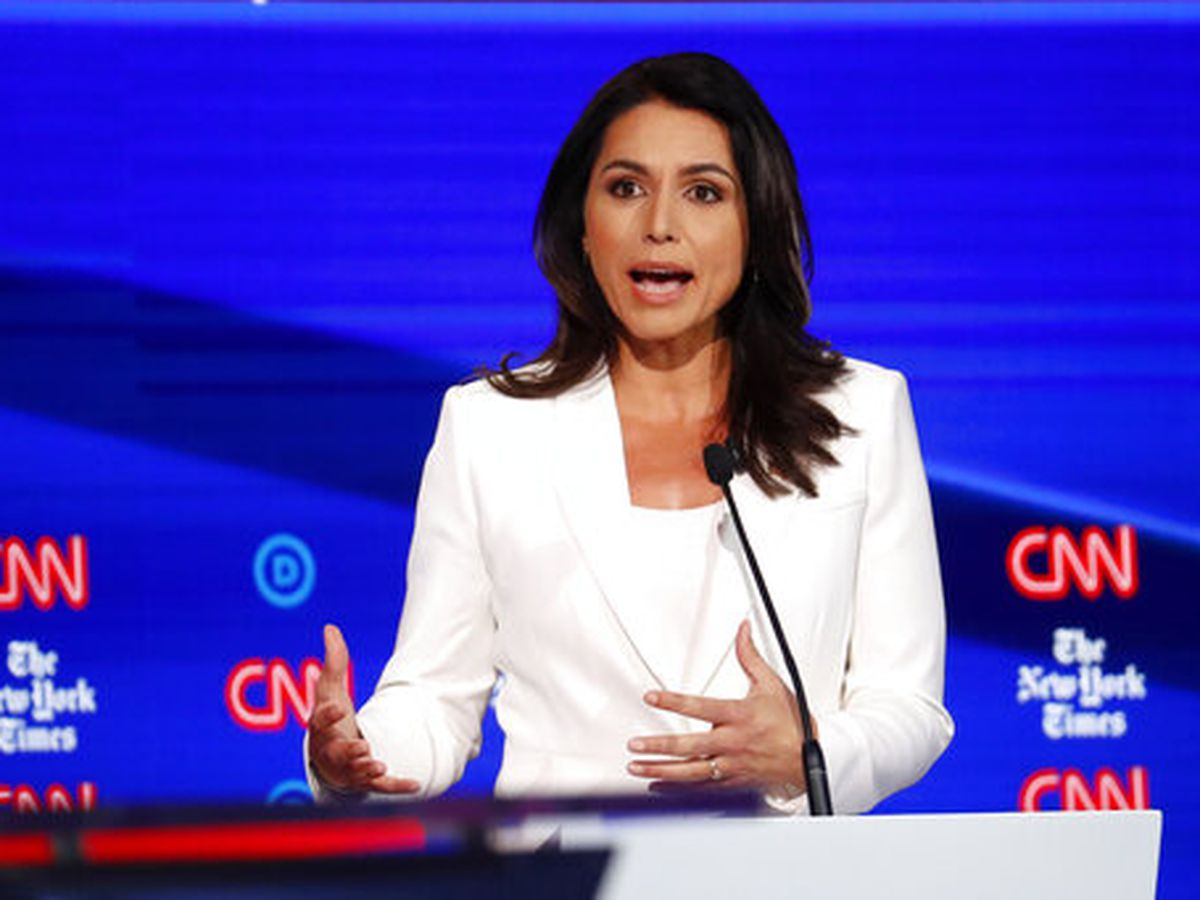 On debate stage, Gabbard claims she's the victim of a 'smear campaign'