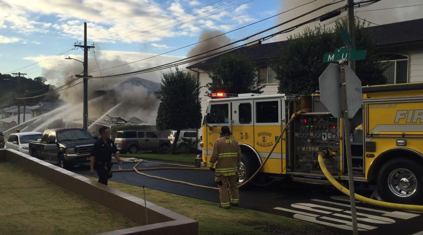 Thick black smoke filled the air as firefighters put out the flames.