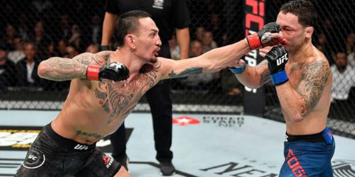 Holloway outclasses Edgar to retain UFC featherweight title