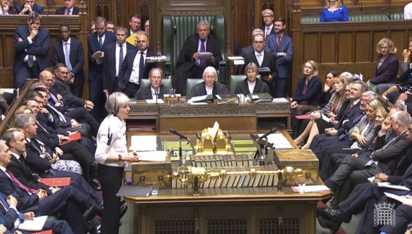 Britain's Prime Minister Theresa May addresses the House of Commons, London, with an update on the latest developments in the Brexit negotiations, Monday Oct. 15, 2018. (PA via AP)